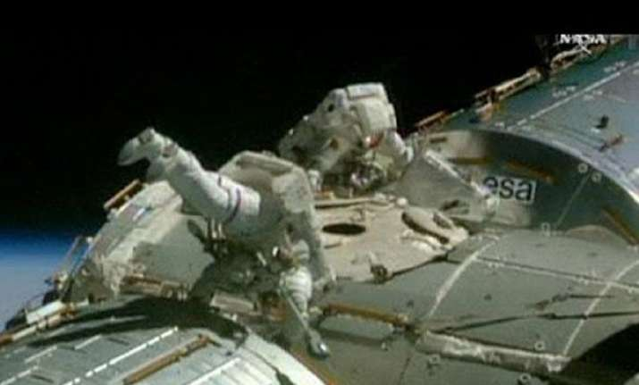 nasa astronauts finish spacewalk trilogy for space taxis