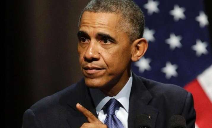 barack obama signs bill allowing congress to review iran s