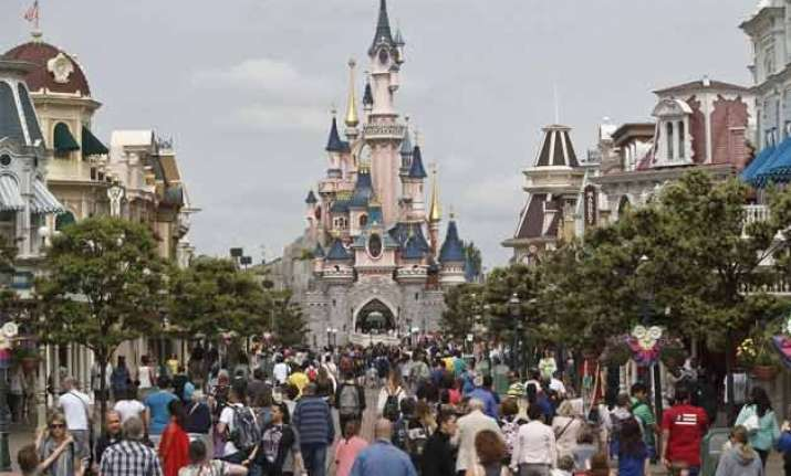 man with 2 handguns partner arrested at disneyland paris