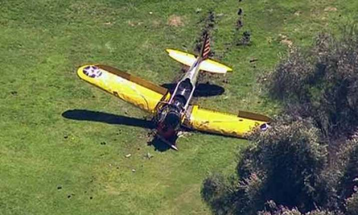 harrison ford crash lands plane on golf course