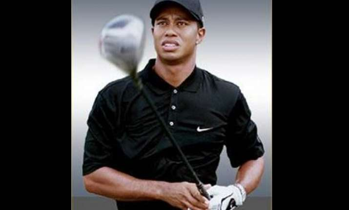 tiger woods to return to golf next month