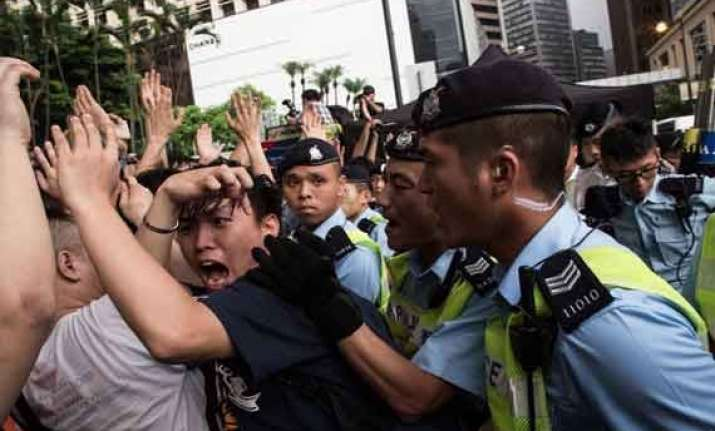 hong kong official warns protesters to face arrest