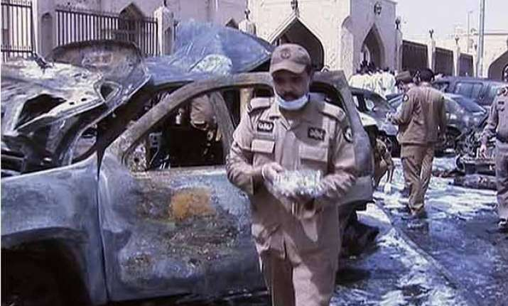 saudi mosque bombing targets police at least 13 dead