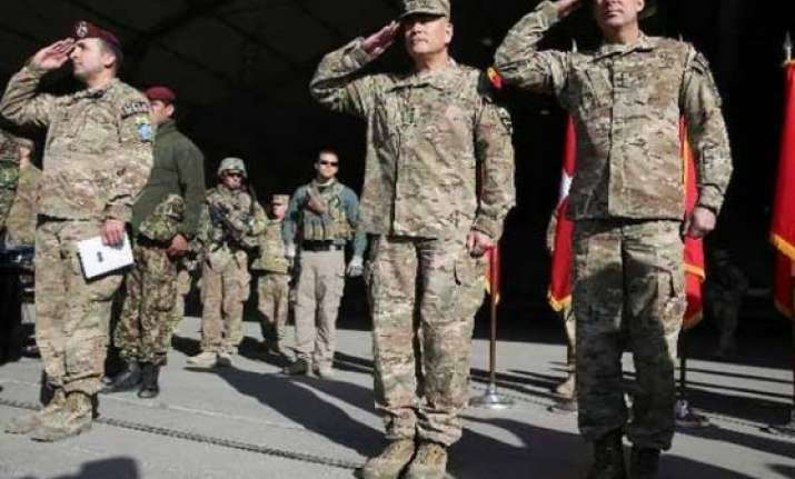 us nato ceremonially end afghan combat mission