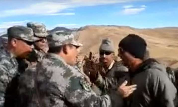 china plays down indian border standoff watch video