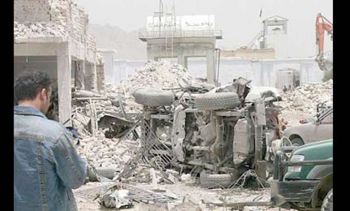 30 die as suicide attackers hit kandahar