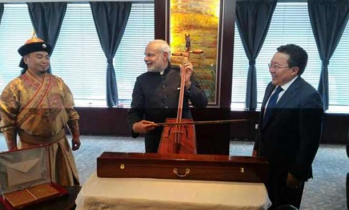 pm modi plays mongolian fiddle strikes new chord in ties