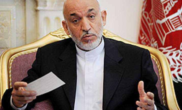 karzai confirms holding talks with taliban