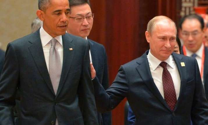 vladimir putin congratulates barack obama calls for talks