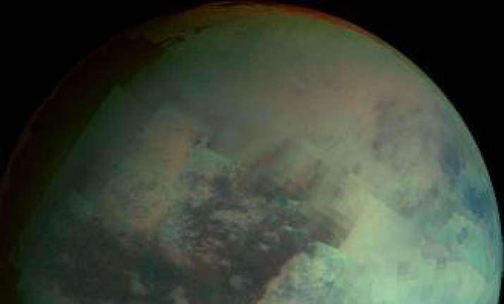 saturn s moon titan glowing at dusk and dawn