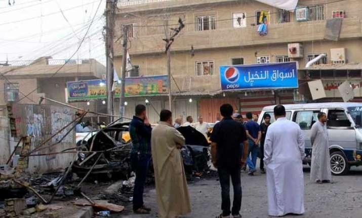 iraq caf blasts kill 20 is claims responsibility