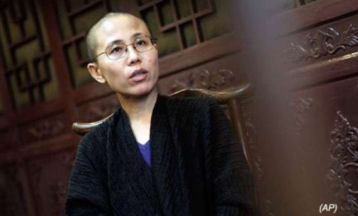 nobel laureate s wife forced to leave beijing