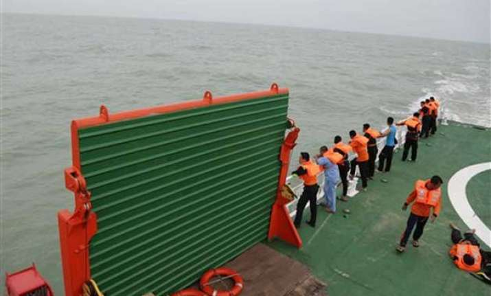 tail of missing airasia plane discovered in java sea