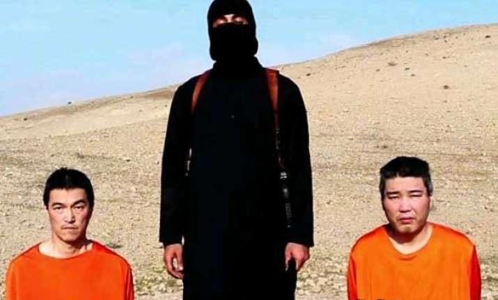 japan condemns new video not yet verifying it s of hostages