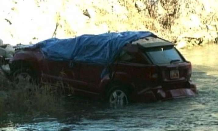 18 month old found alive 14 hours after car plunges into