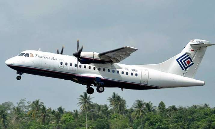 missing indonesian plane s wreckage found in remote papua