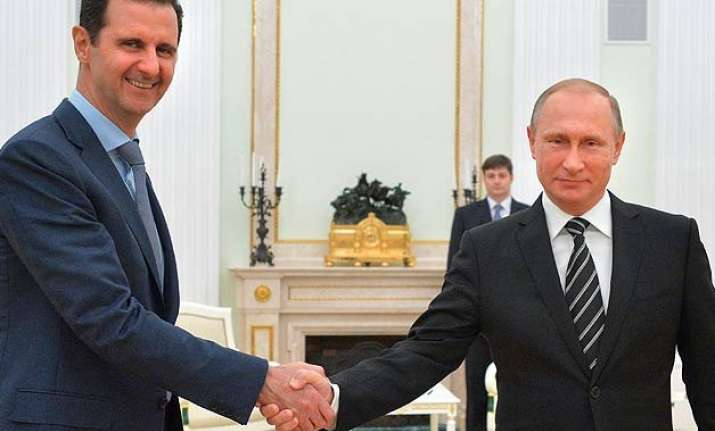 syrian president assad travels to moscow meets putin