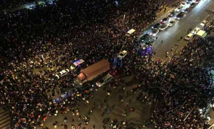 new year stampede kills 36 in china s financial hub