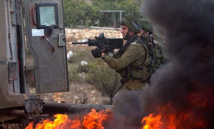 violence spreads to gaza israeli troops kill 6 palestinians