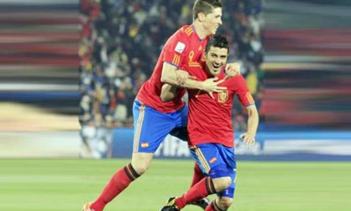 villa double gives spain win over honduras