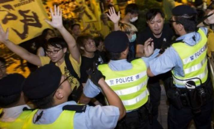 hong kong police arrest 19 at protest site