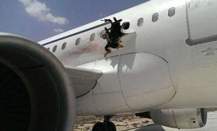 bomb horror man sucked out as explosion forces plane to