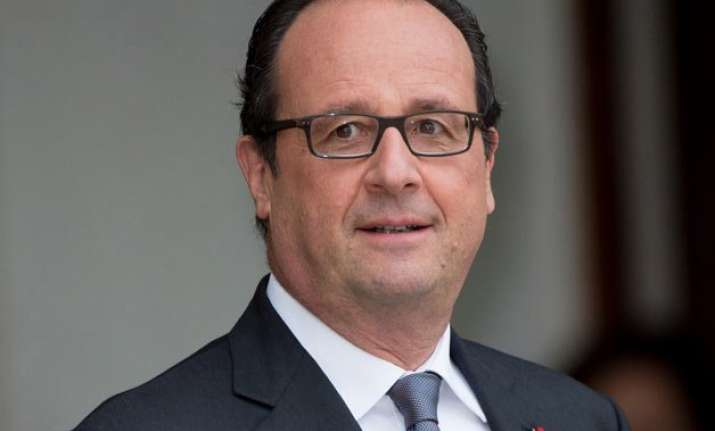 french president pardons woman convicted of killing abusive