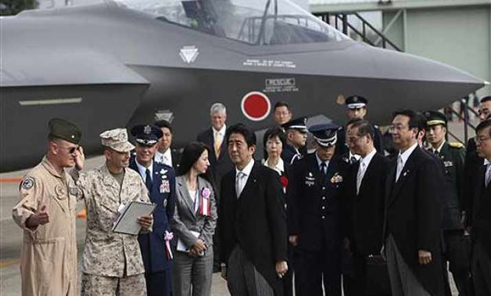japan cabinet okays record military budget with eye on china