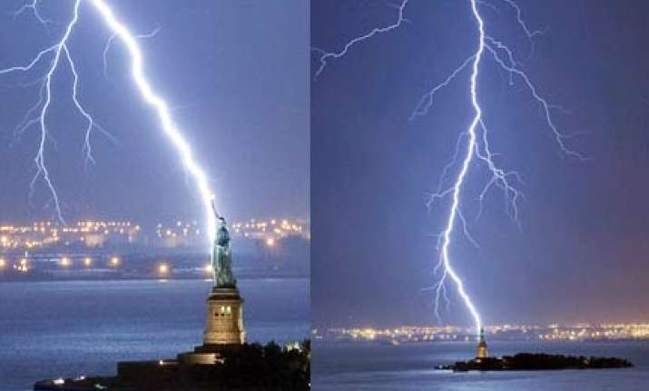 amazing pic of huge lightning bolt striking statue of