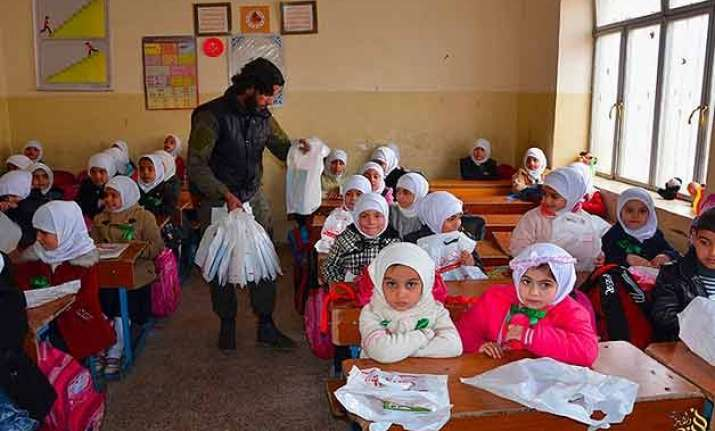 in an is training camp children told behead the doll