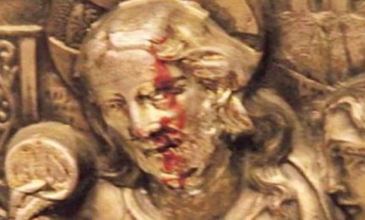 red liquid said to be blood oozes from christ s face in