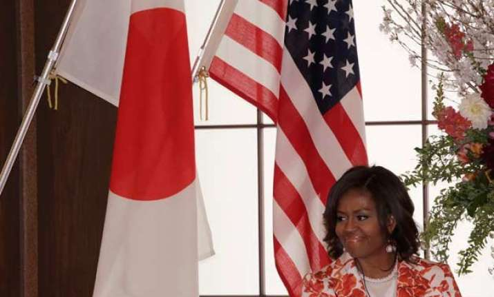 michelle obama visits japan to showcase girls education aid