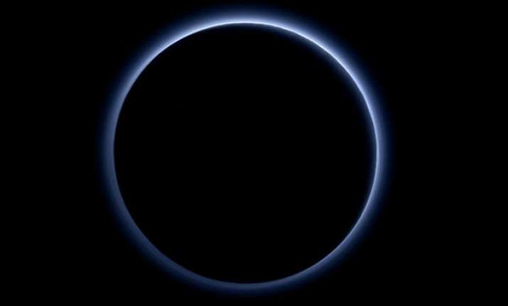 blue sky and red ice at pluto nasa spacecraft discovers