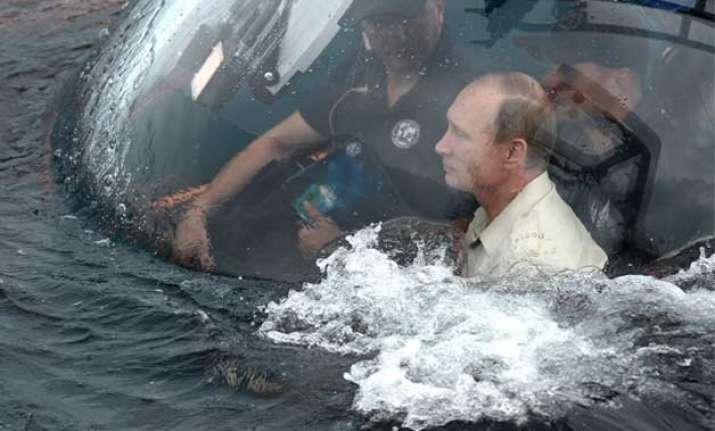russia s stunt loving vladimir putin rides to bottom of