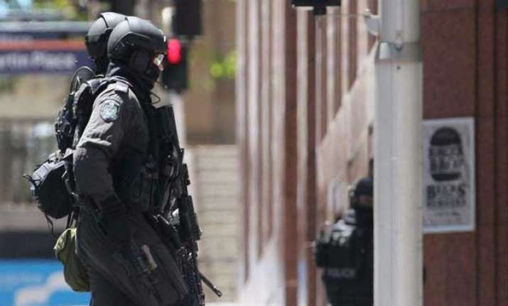 sydney cafe seige victim reportedly shot dead by police