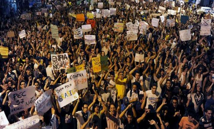 thousands of people march against brazilian president