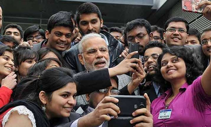 pm narendra modi clicks selfie with indian students in