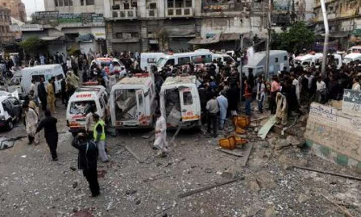 suicide bombing at shiite procession kills 20 in pakistan
