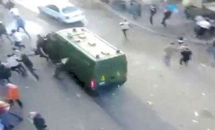 video shows police van running over protesters in cairo .