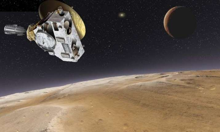 nasa probe flies past pluto world awaits historic images