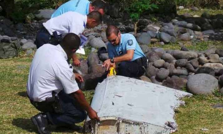 likely piece of doomed flight mh370 found in mozambique