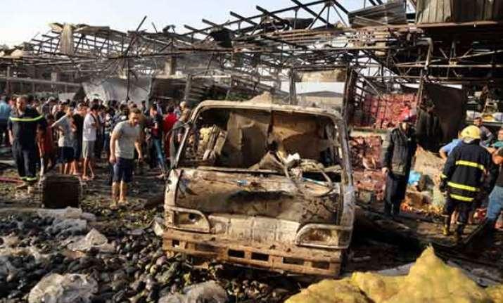truck bombing at baghdad market kills 67 islamic state