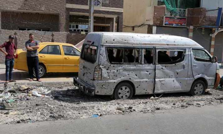 20 killed by two car bombs in iraq
