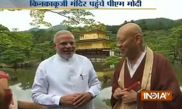 narendra modi greets buddhist head monk says i am modi you