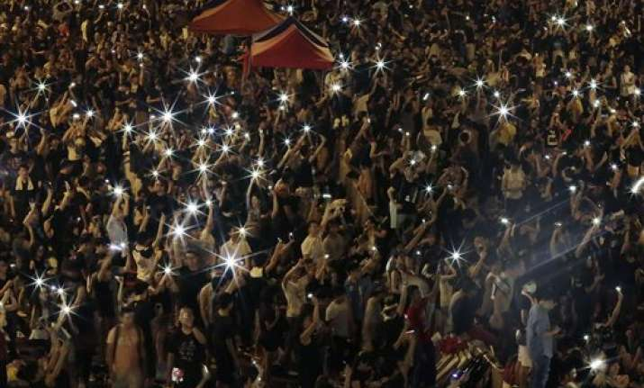 hong kong protesters stage massive defiant rally