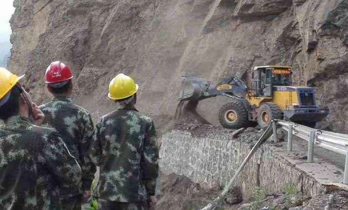 chinese soldiers repair highway in nepal
