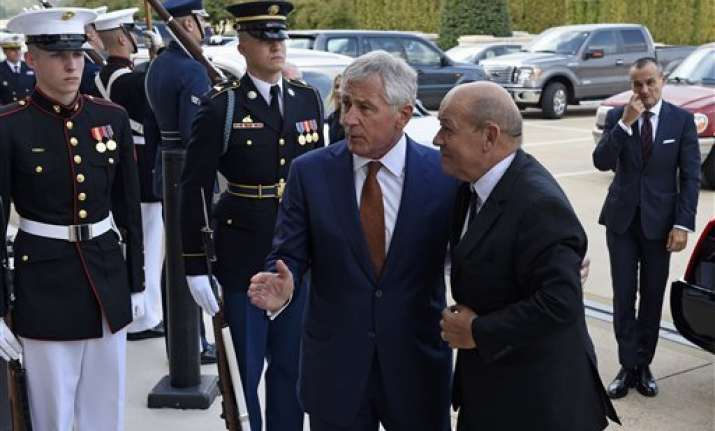 hagel french minister talk about syria strikes