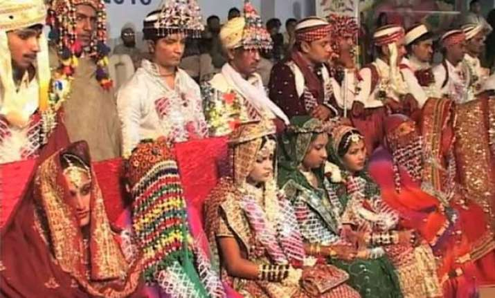 drumbeats roll 60 hindu couples tie knot at mass wedding in
