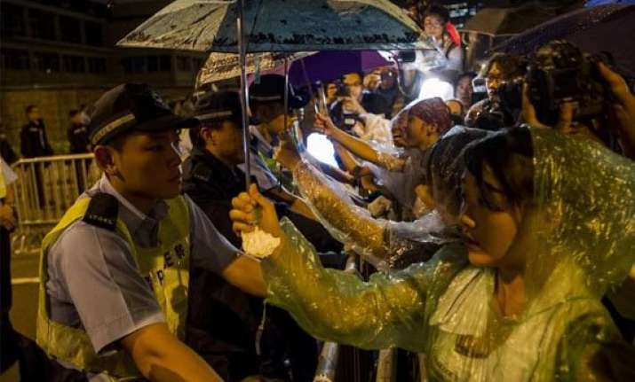china backs hk leader as pressure to quit grows