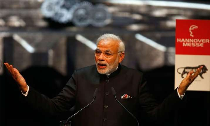 pm modi woos investors in germany promises predictable tax